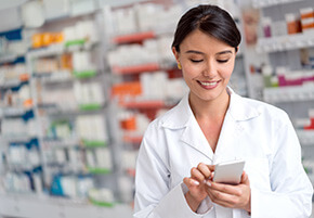 pharmacy tech with mobile device